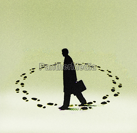 businessman walking in endless circle