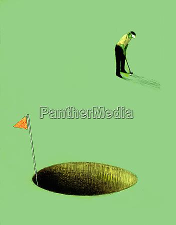 golfer steckt in ueberdimensionales loch
