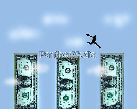 businessman jumping across gaps between dollar
