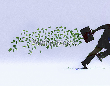 money falling from briefcase of running
