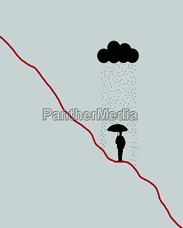businessman sheltering from rain on descending