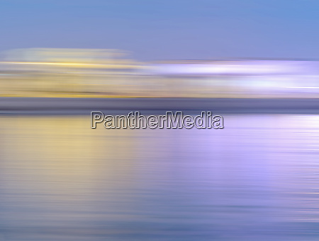 abstract blurred motion skyline over water