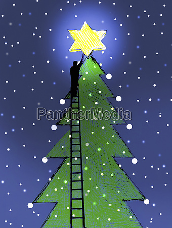man on ladder placing glowing star