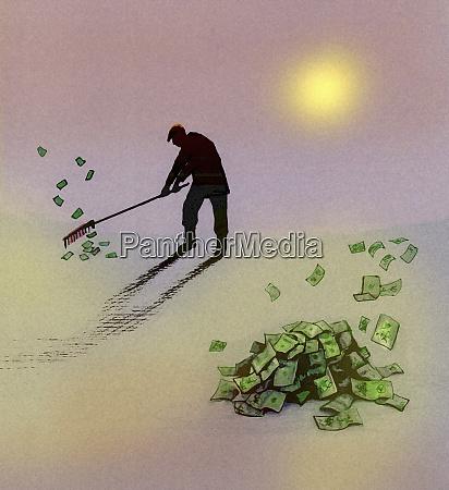 man raking up piles of money