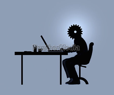 office worker at desk with cog