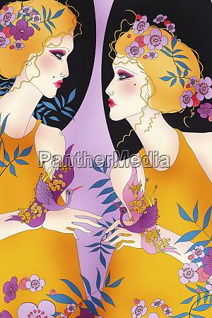 beautiful twin women in flowers as