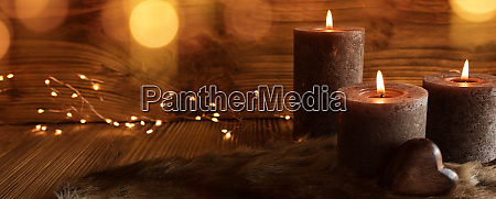 decoration with candles on wooden background