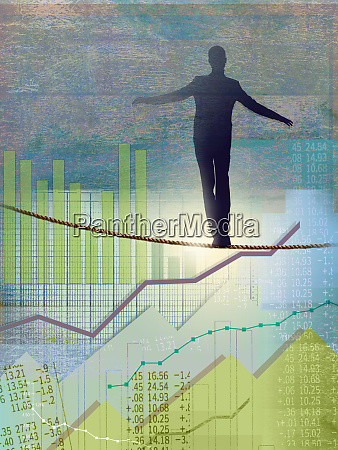 businessman walking tightrope over graphs and