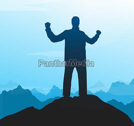 silhouette of successful man on mountain