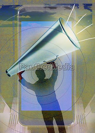 man holding megaphone aloft over smartphone