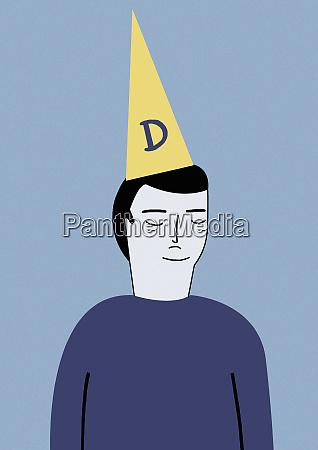 man wearing dunce cap