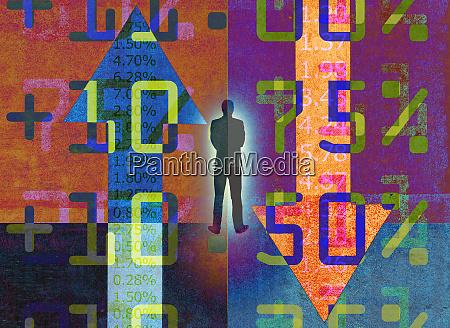 businessman analyzing contrasting financial figures