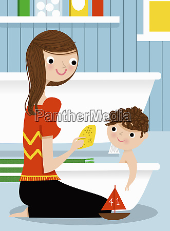 mutter badet sohn in babybadewanne
