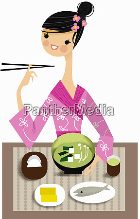 woman in traditional clothing enjoying japanese
