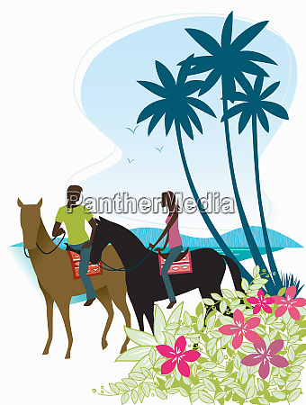 couple horseback riding on beach
