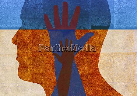 hands reaching inside of mans head