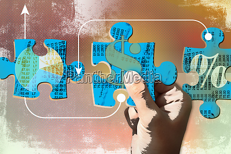 hand connecting finance jigsaw puzzle pieces