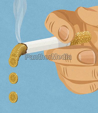 hand haelt rauchen dropping pfunden asche