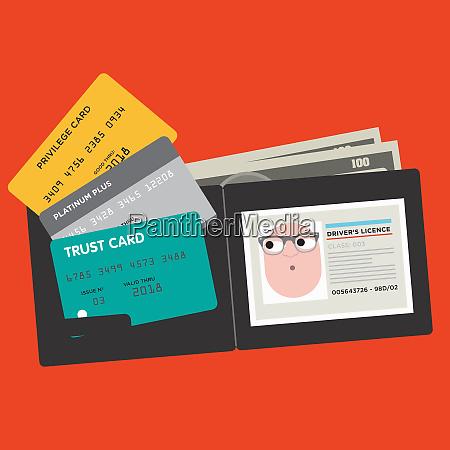 verschiedene kreditkarten und fuehrerschein in mans