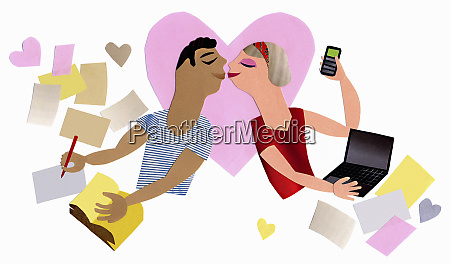 kissing couple using laptop phone and