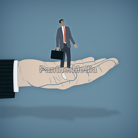 businessman standing on helping hand