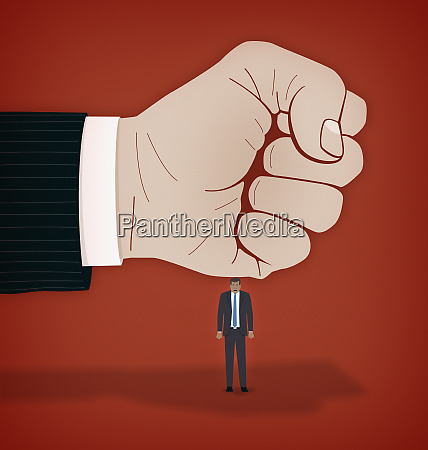large fist hitting businessman on head