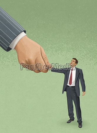 large hand shaking hands with small