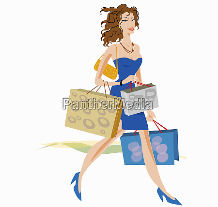 glamorous woman carrying lots of shopping