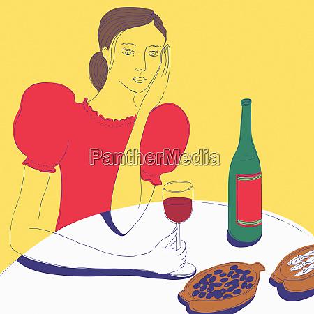 frau beim trinken von rotwein mit