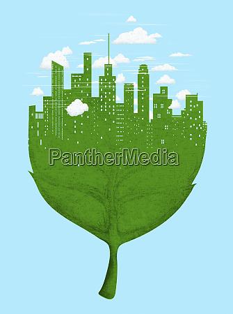 city skyline on green leaf
