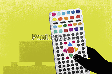 hand holding complicated remote control