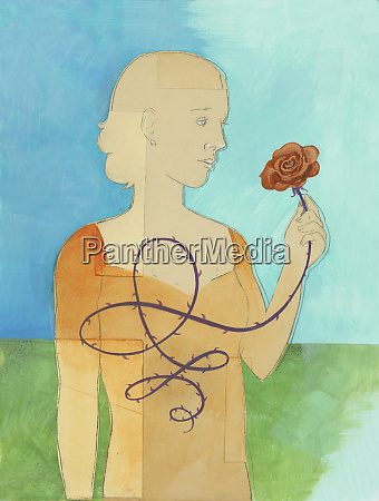 woman holding rose from thorny stem
