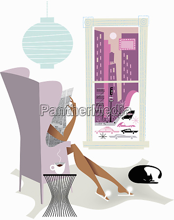 woman relaxing reading newspaper in wingback