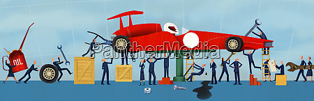 business people working together as mechanics