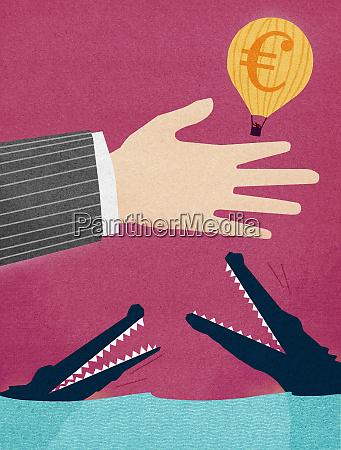 businessman releasing euro hot air balloon