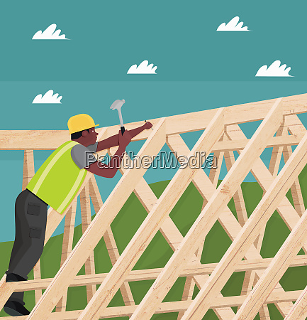construction worker hammering nail into roof
