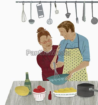 AElteres ehepaar geniesst gemeinsames kochen