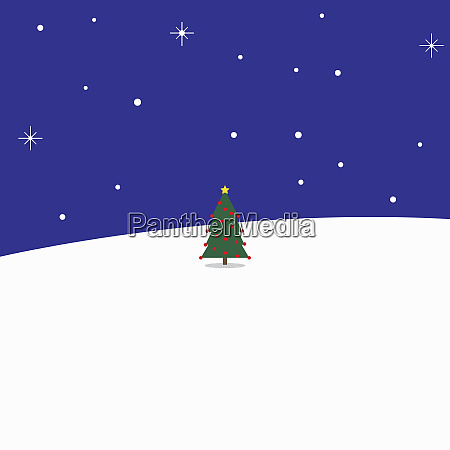 small decorated christmas tree in snow