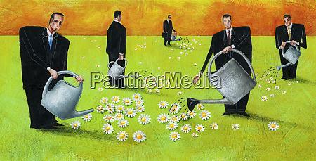 businessmen watering flowers