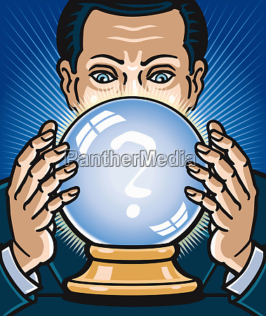 businessman looking at crystal ball