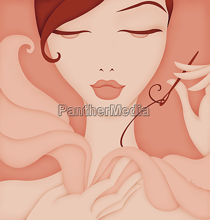 beautiful woman sewing fabric wings posing