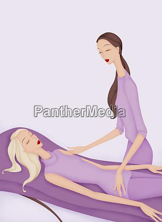 beautiful woman receiving massage in spa