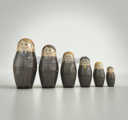 businessmen nesting dolls in order of