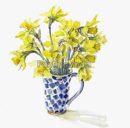 bunch of daffodils in mug