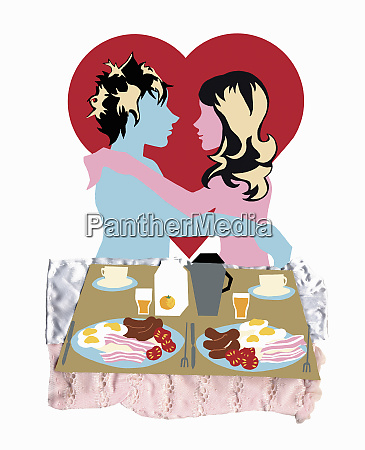 young couple embracing with breakfast in