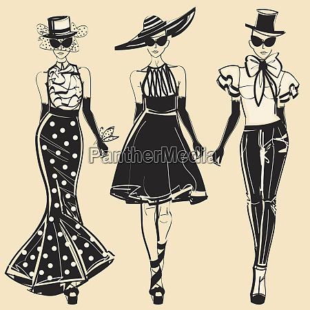 three fashion models wearing elegant clothing
