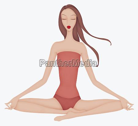 schoene frau uebt yoga