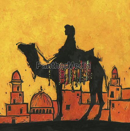 silhouette von kamel und reiter gegen