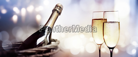 cheers with a bottle of champagne