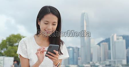 woman using smart phone in hong